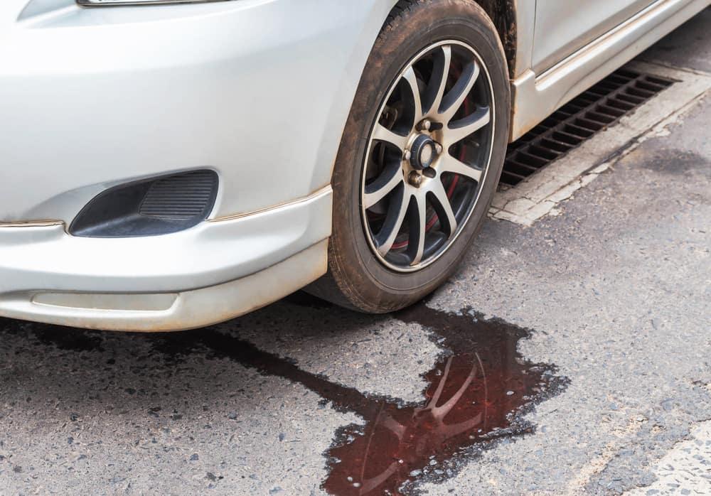 White car leaking radiator fluid underneath