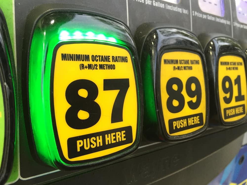 Yellow and black octane rating buttons at a gas station