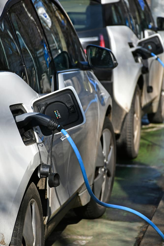 Row of cars at an electric charging station