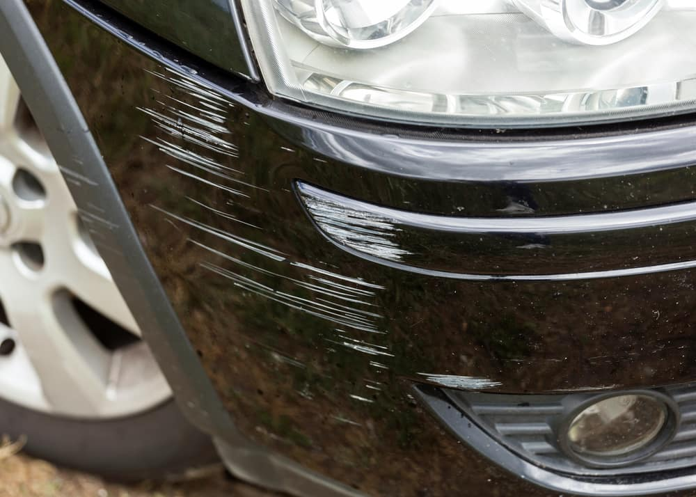 paint scratches on black bumper of a car