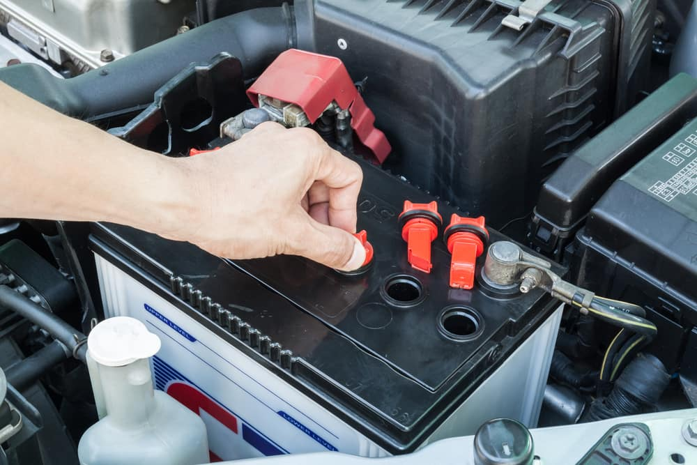 Car Battery Being Worked On for Car Maintenance