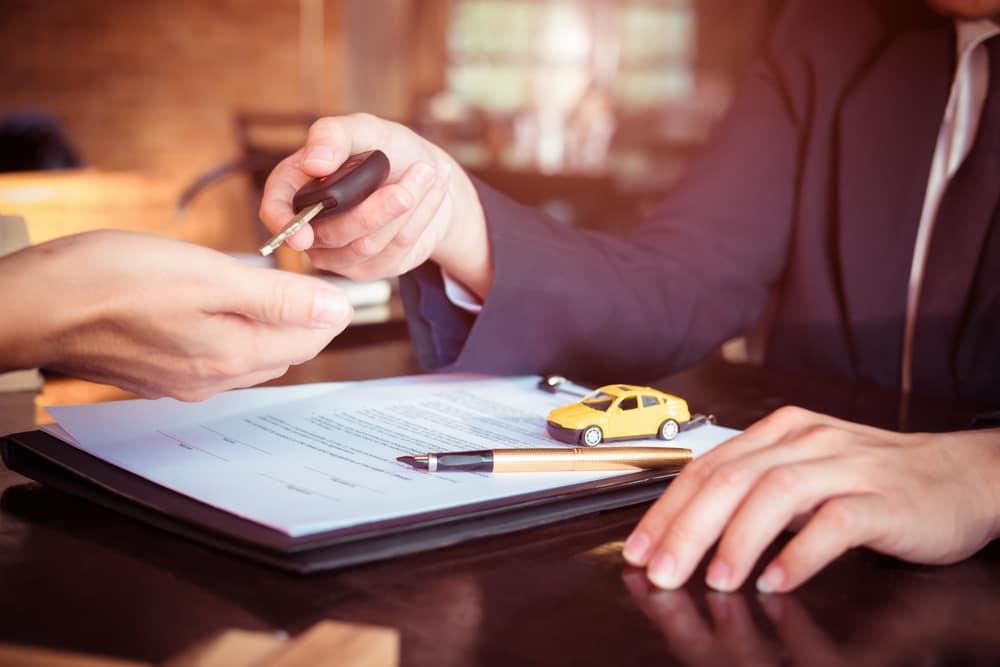 Car Salesperson Holding Keys Car Buying Concept