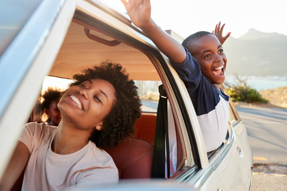 Mom and Son Relaxing With Car Windows Down