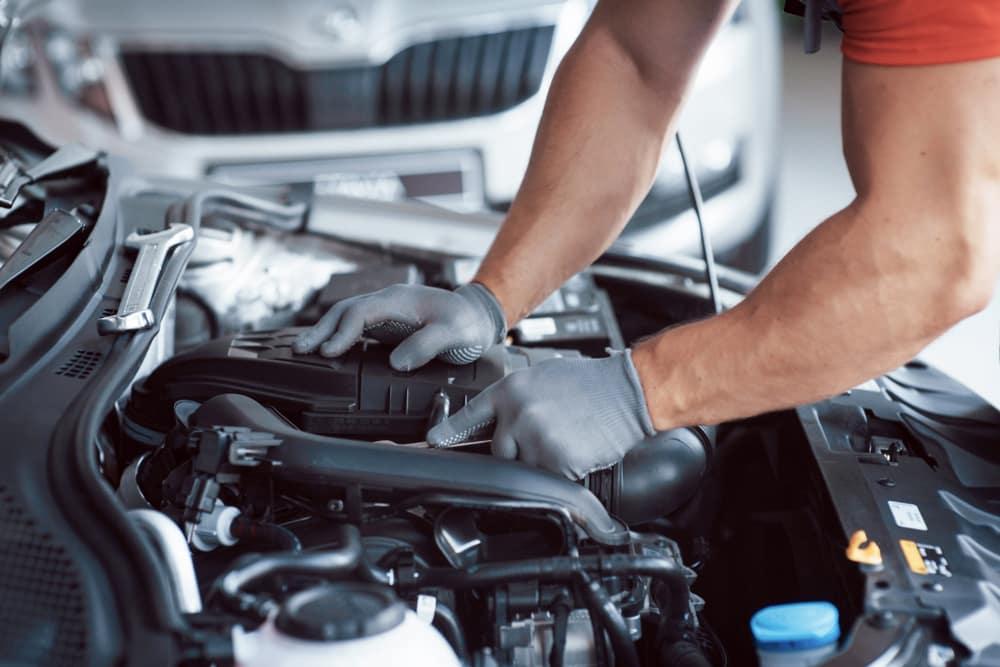 Car Mechanic Fixing a Vehicle