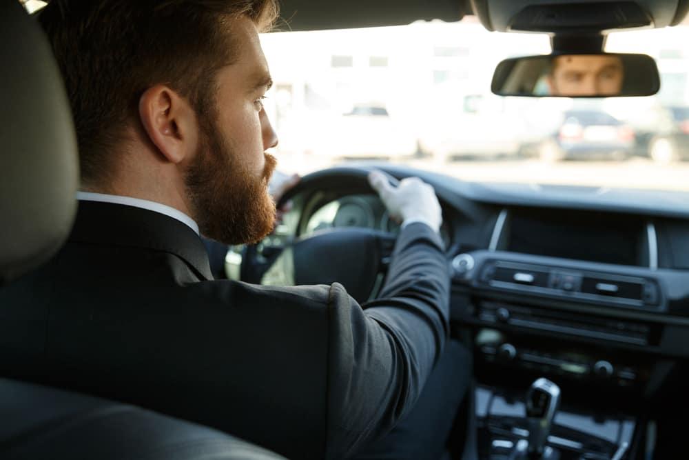 Man Driving Car to Work