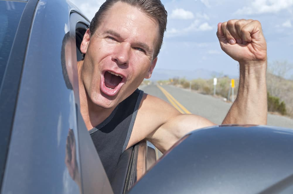 Man Driving With the Windows Down