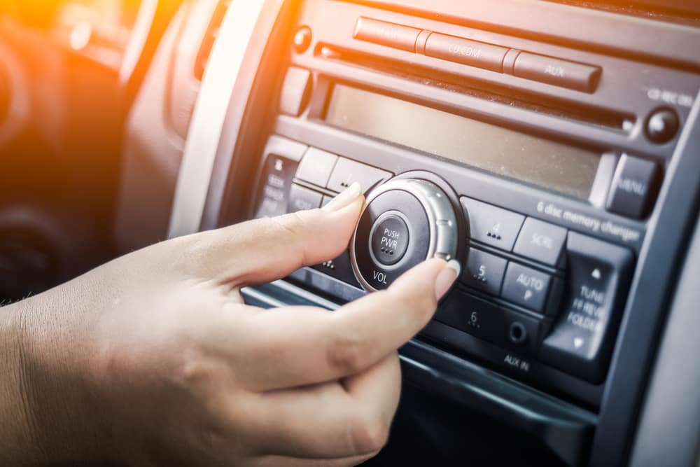 Person Increasing Volume of Car Stereo
