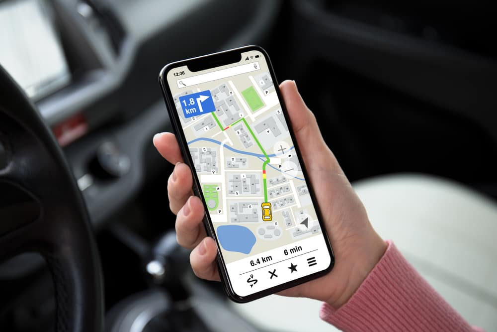Person Using Map App in a Car