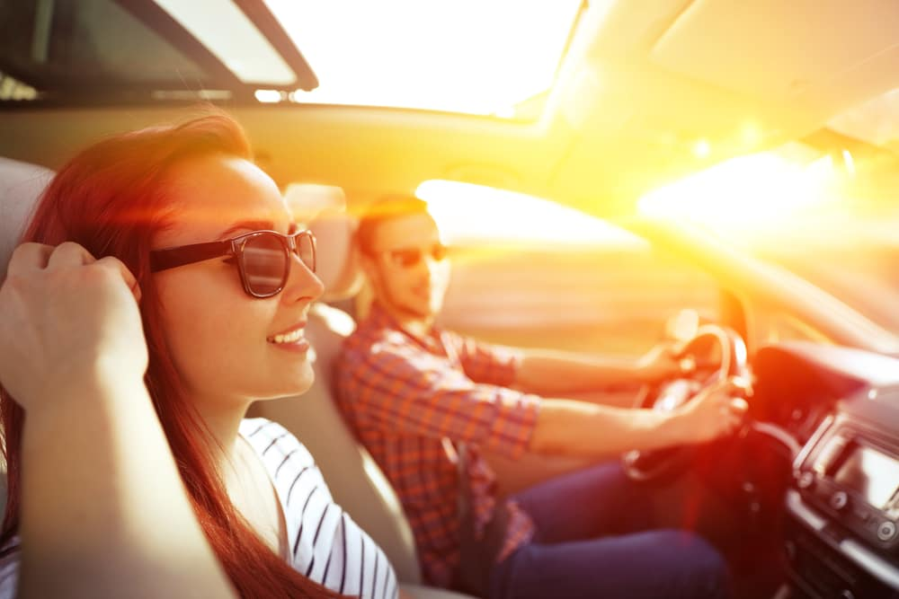 Young Couple Driving in the Summer Sunshine