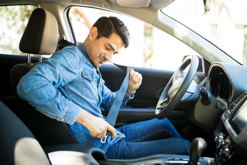Young Man Fastening a Seatbelt