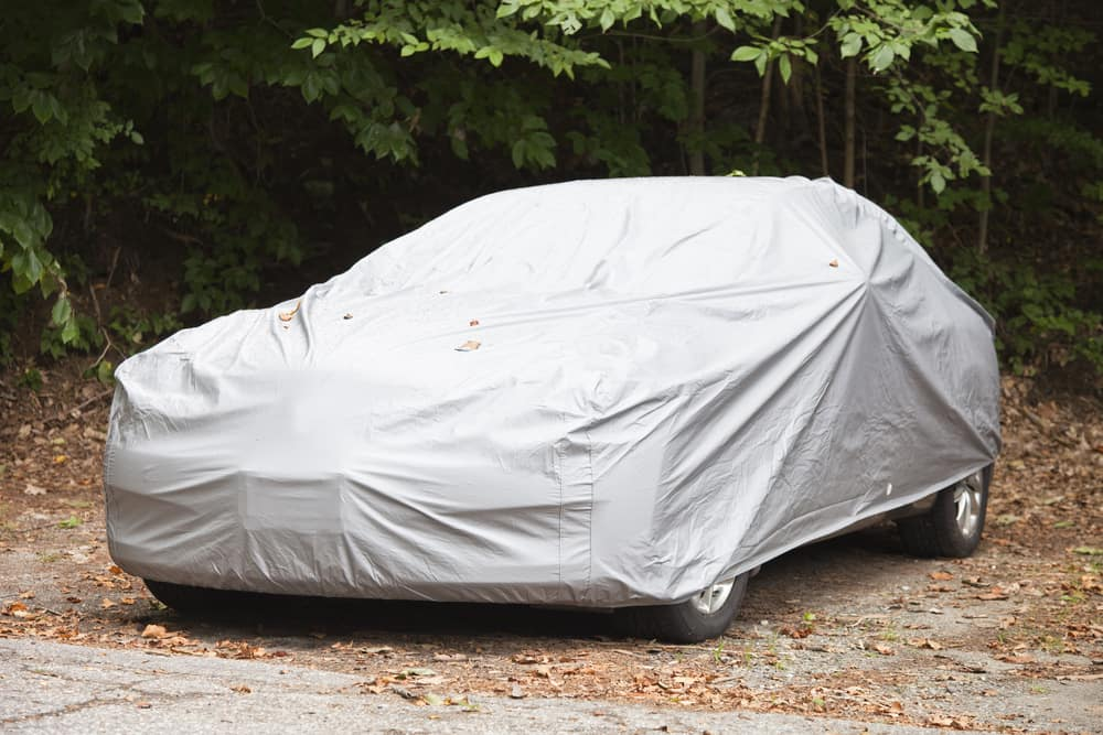 Car covered in tarp for storage