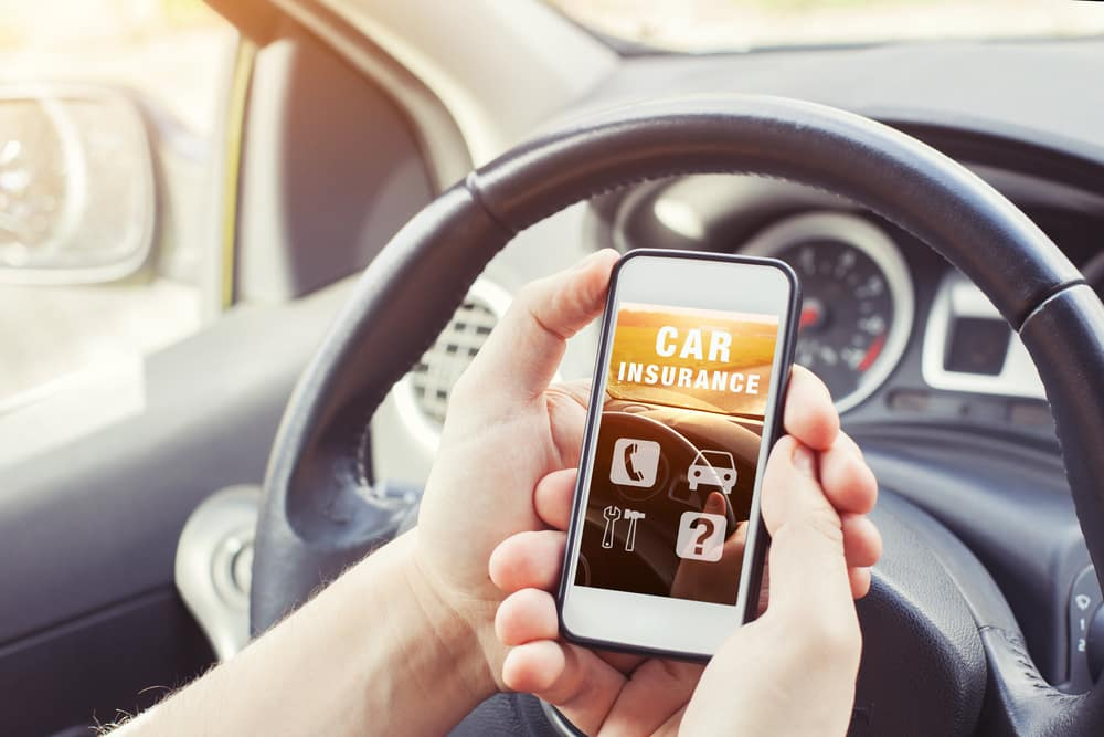 Man researching car insurance on a smartphone