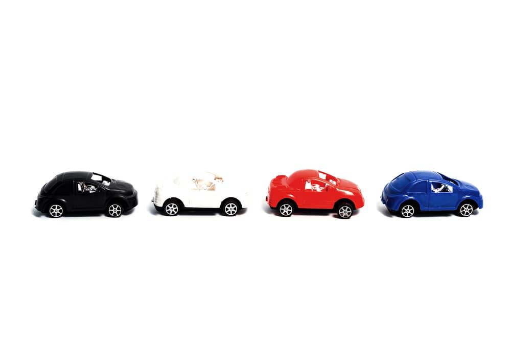 Miniature cars in a line