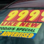 Used Car Windshield with Pricing Information
