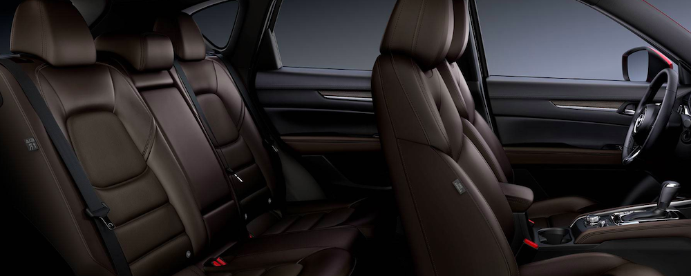 An image of the spacious Mazda CX-5 interior with luxurious brown seating.