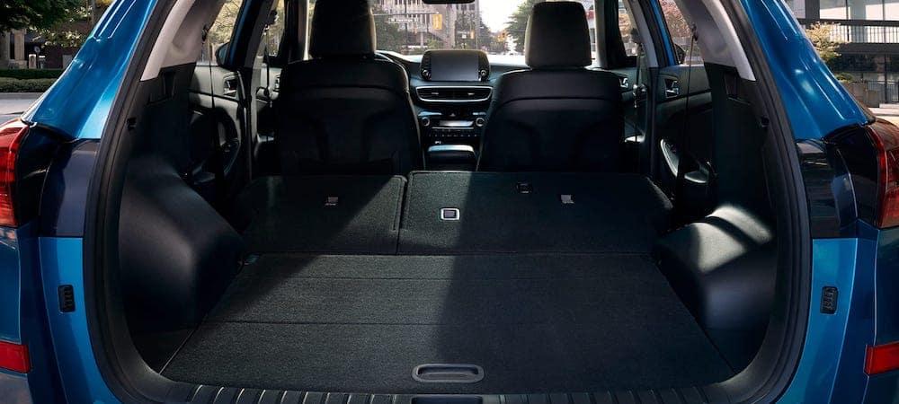 Blue 2019 Hyundai Tucson trunk with seats down