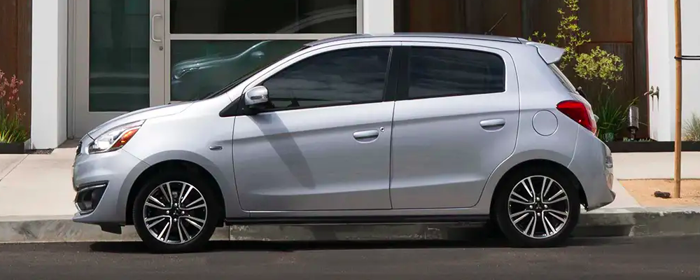 Side view of Silver 2019 Mitsubishi Mirage parked on city street