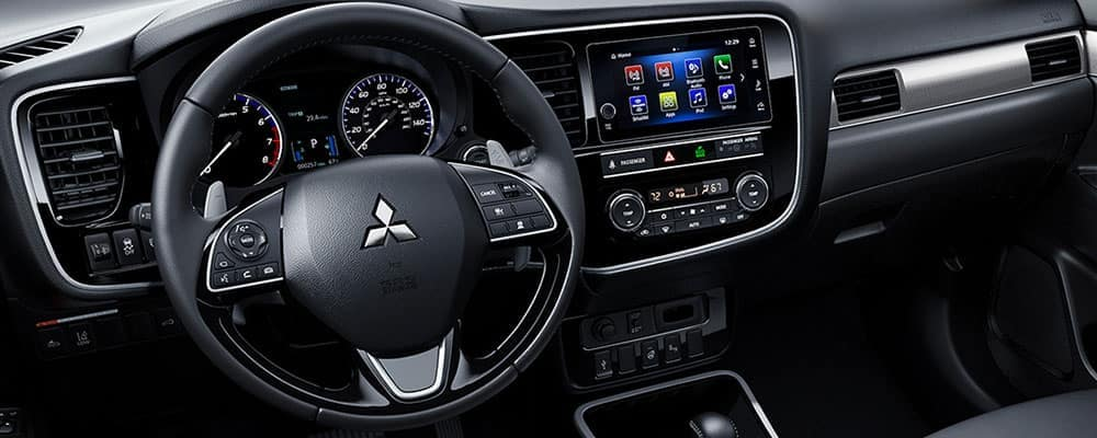Close on 2019 Mitsubishi Outlander interior steering wheel with console with Mitsubishi Car App