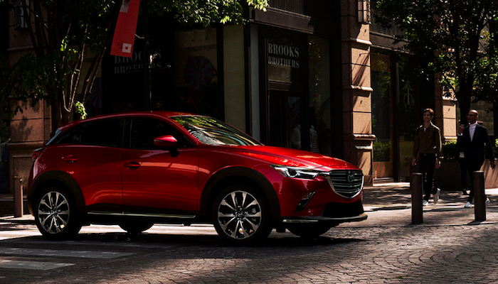 Red Mazda CX-3 in crosswalk