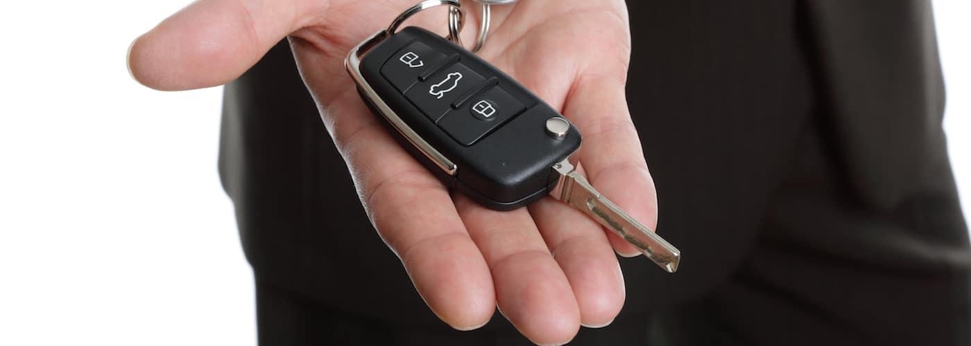 Man Holding Key Fob