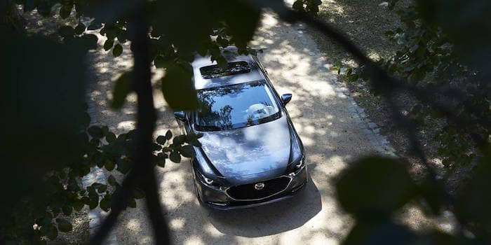 Aerial view of Mazda3 Sedan from trees