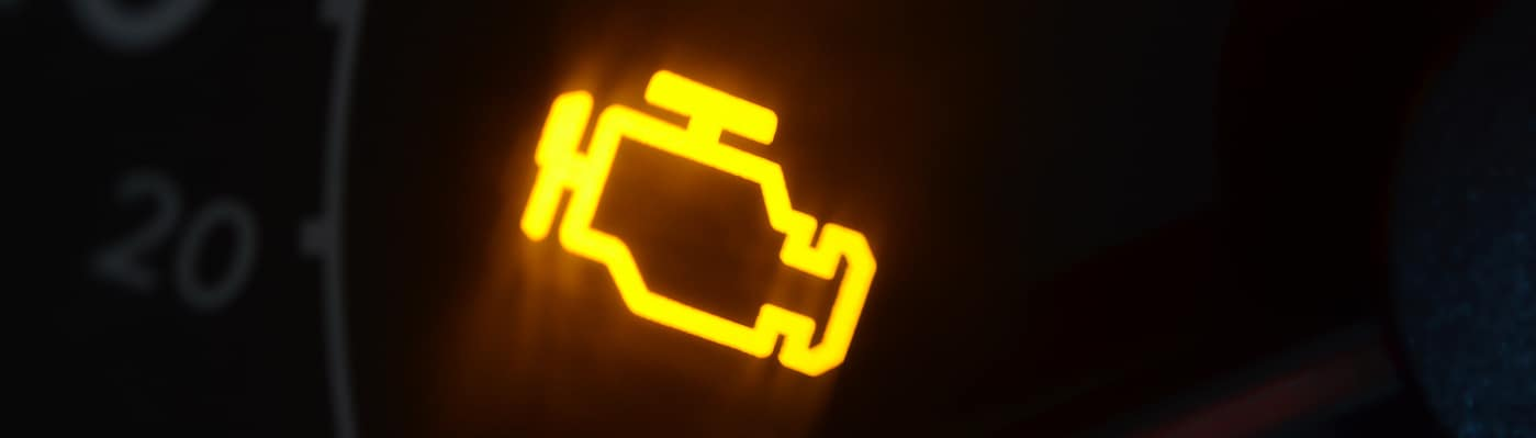 Closeup of check engine light dashboard warning symbol