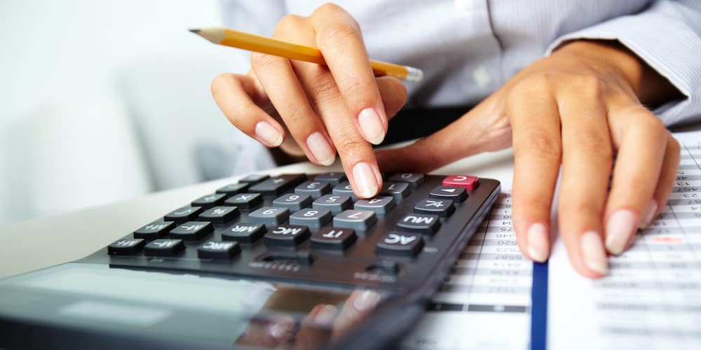 Using a calculator to figure out finances